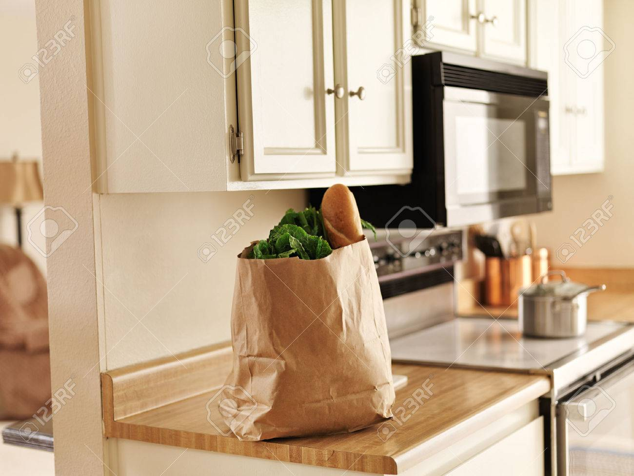 kitchen counter with food. Paper Grocery Bag Of Freshly Bought Food From Store Sitting On Kitchen Counter Stock Photo - With I