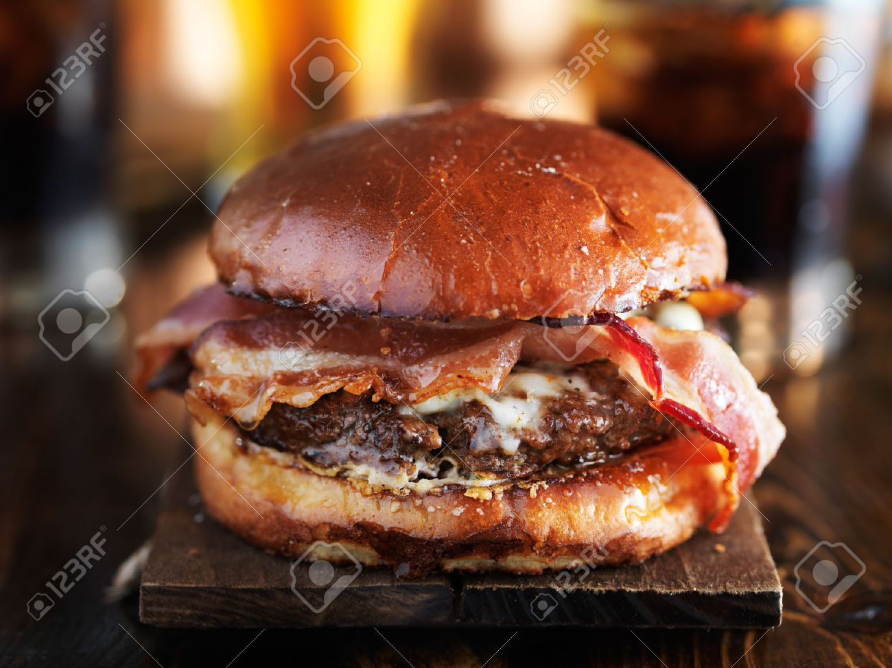 juicy gourmet cheeseburger with melted pepper jack and strips of crispy bacon - 52915939