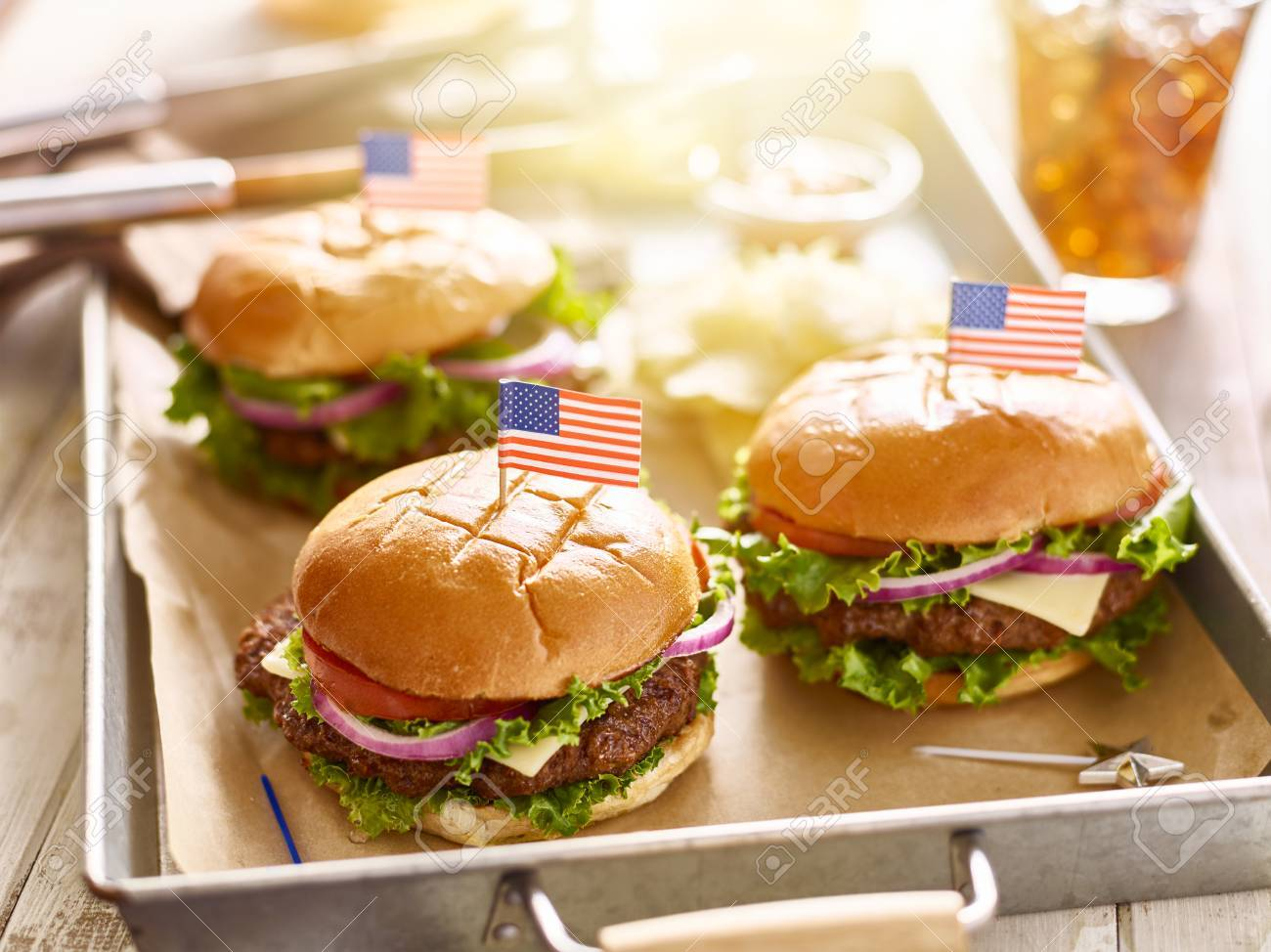 cheese burgers on tray with flags in 4th of july theme - 57890863