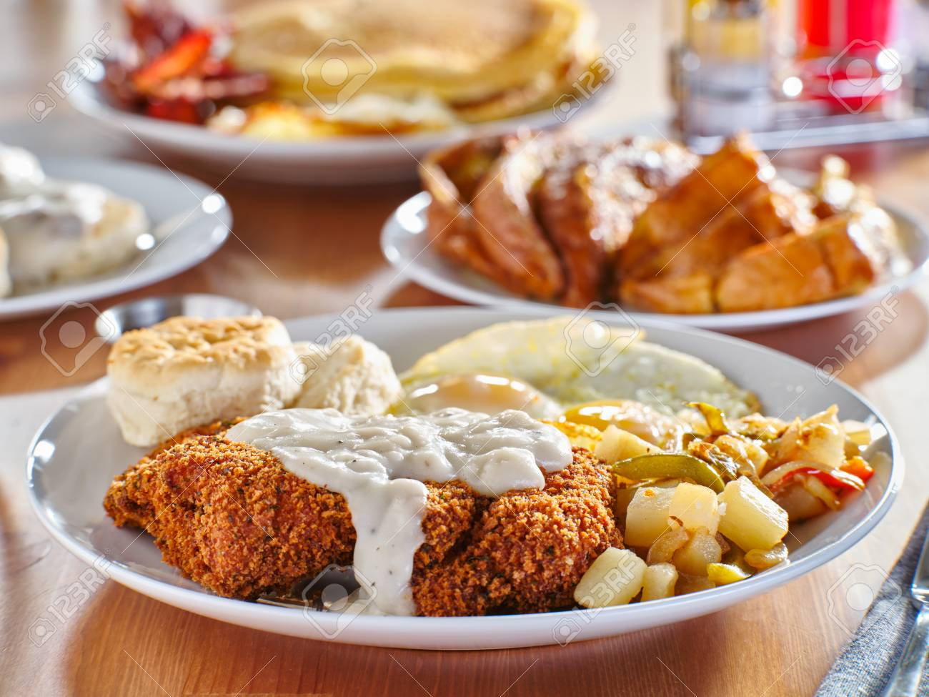 Chicken Fried Steak Covered In Gravy With Sunny Side Up Eggs