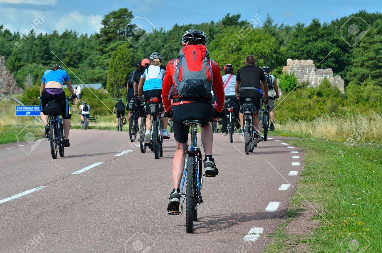 A group of cyclists going on the road in the countryside - 12439432