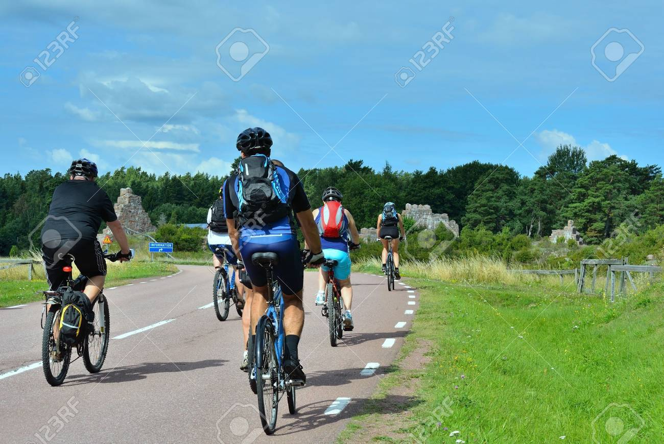 group of cyclists going on the road in the countryside - 12734278