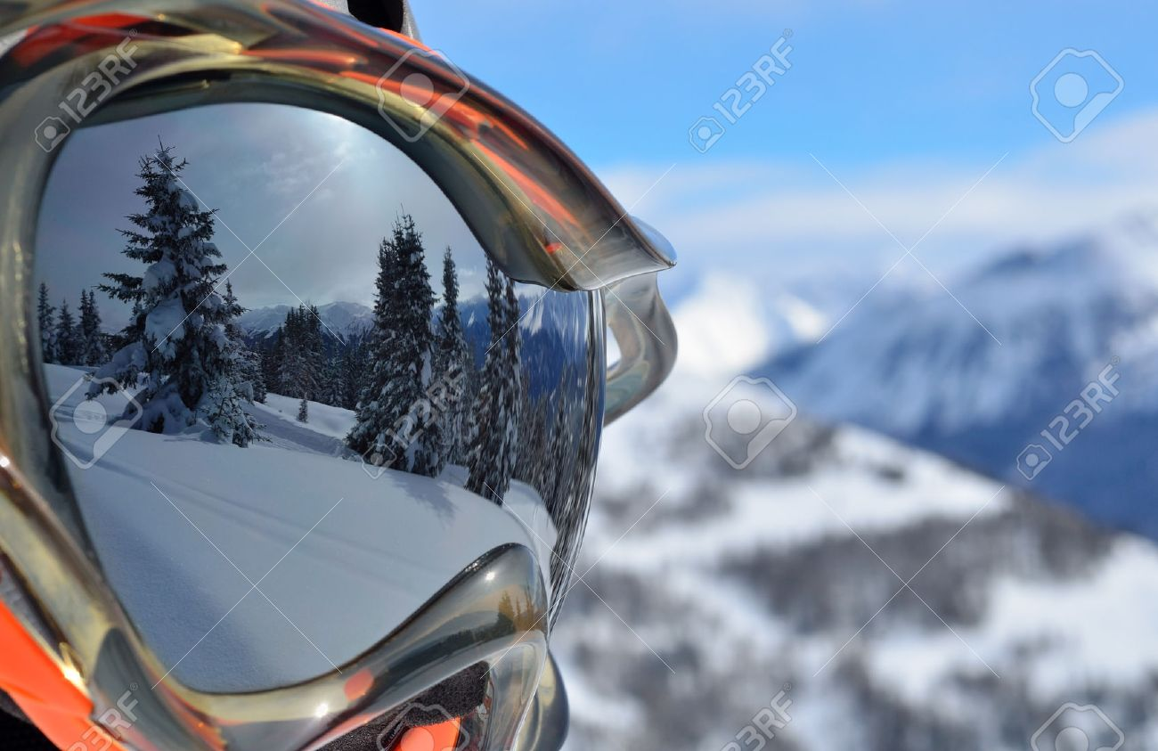 Reflection of the winter mountain landscape in a ski mask - 24748177