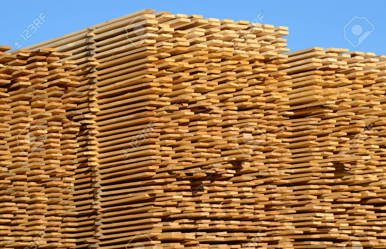 wooden boards stacked at the timber yard - 44652947