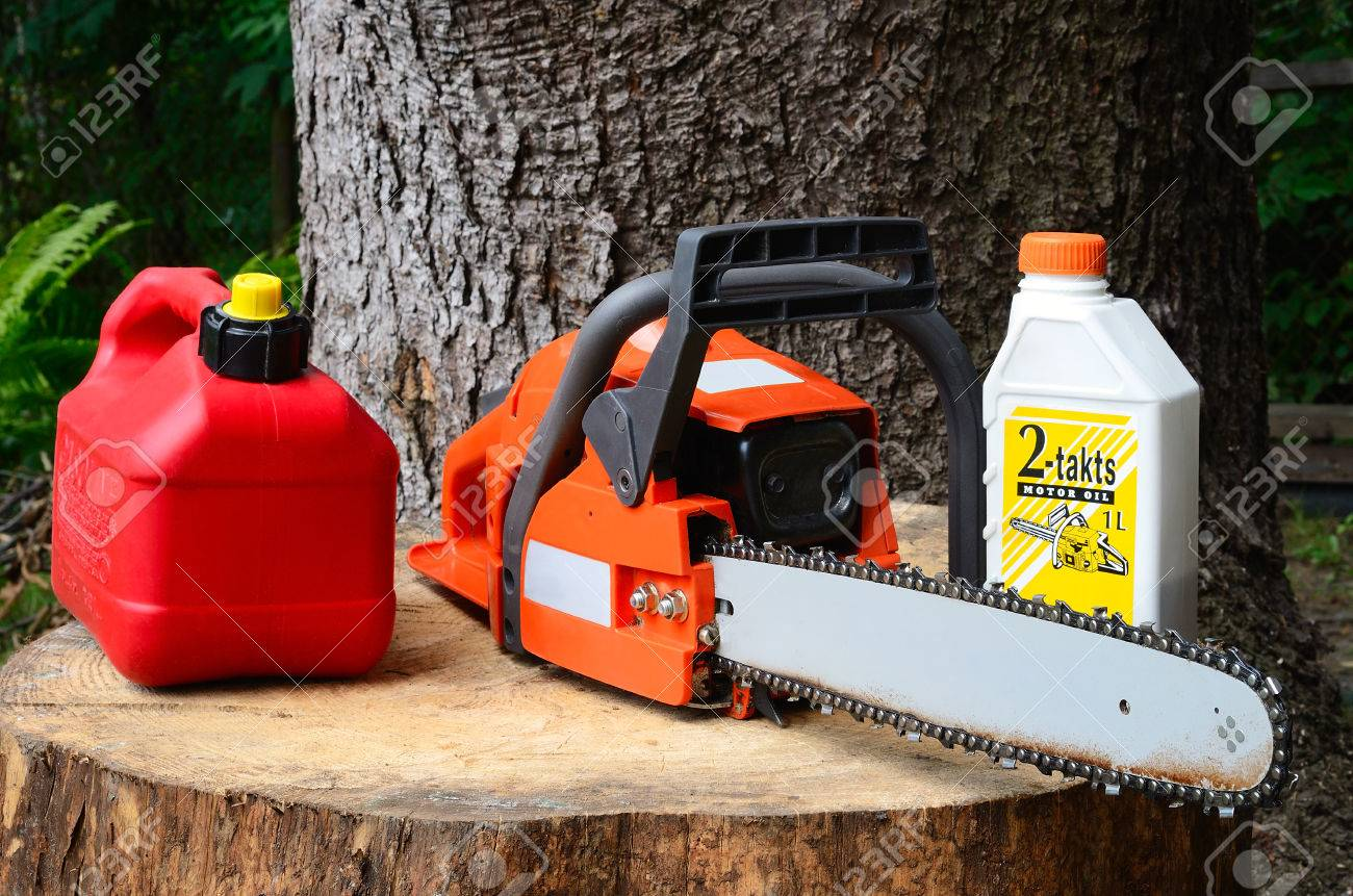 chainsaw and canister of gasoline and motor oil - 61838770