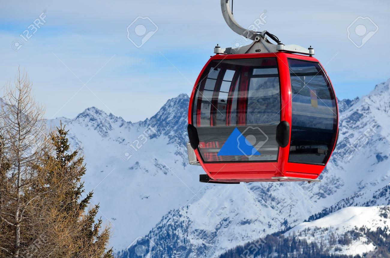 red cable car in the skiing resort in Alps - 68181202