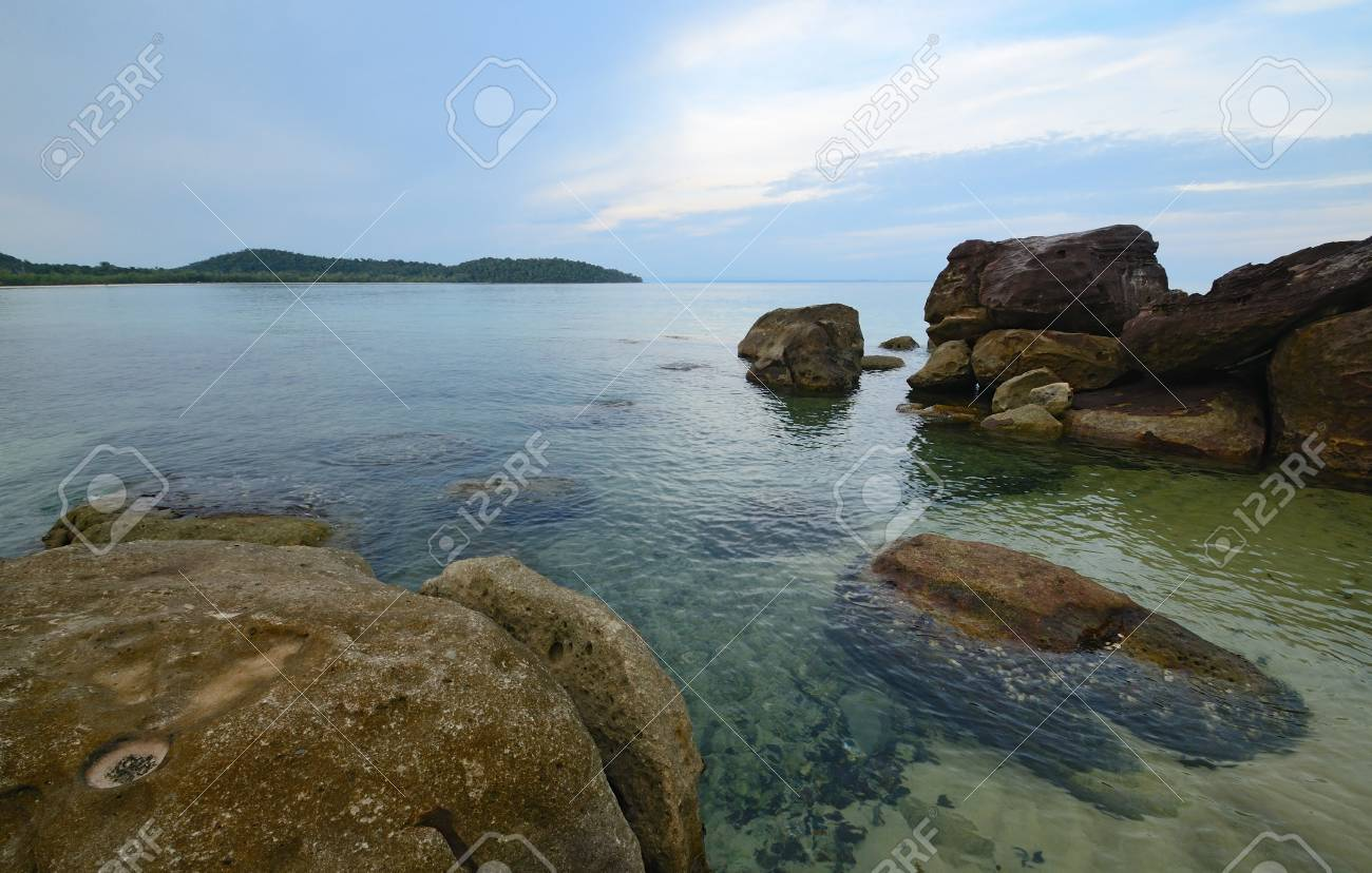 sea view on tropical island with crystal clear water in the evening light - 74620565
