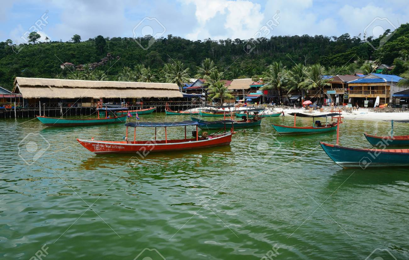 KOH RONG ISLAND, CAMBODIA - JULY 27, 2015: Village view with traditional khmer boats on the beach of Koh Rong Island near Sihanoukville, Gulf of Thailand, Cambodia - 72821627