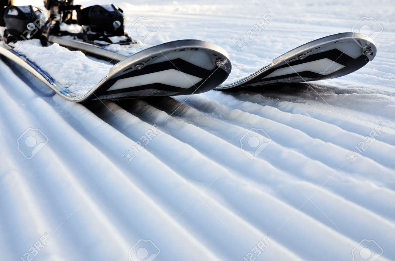 alpine skis in the snow on a prepared slope - 160984345