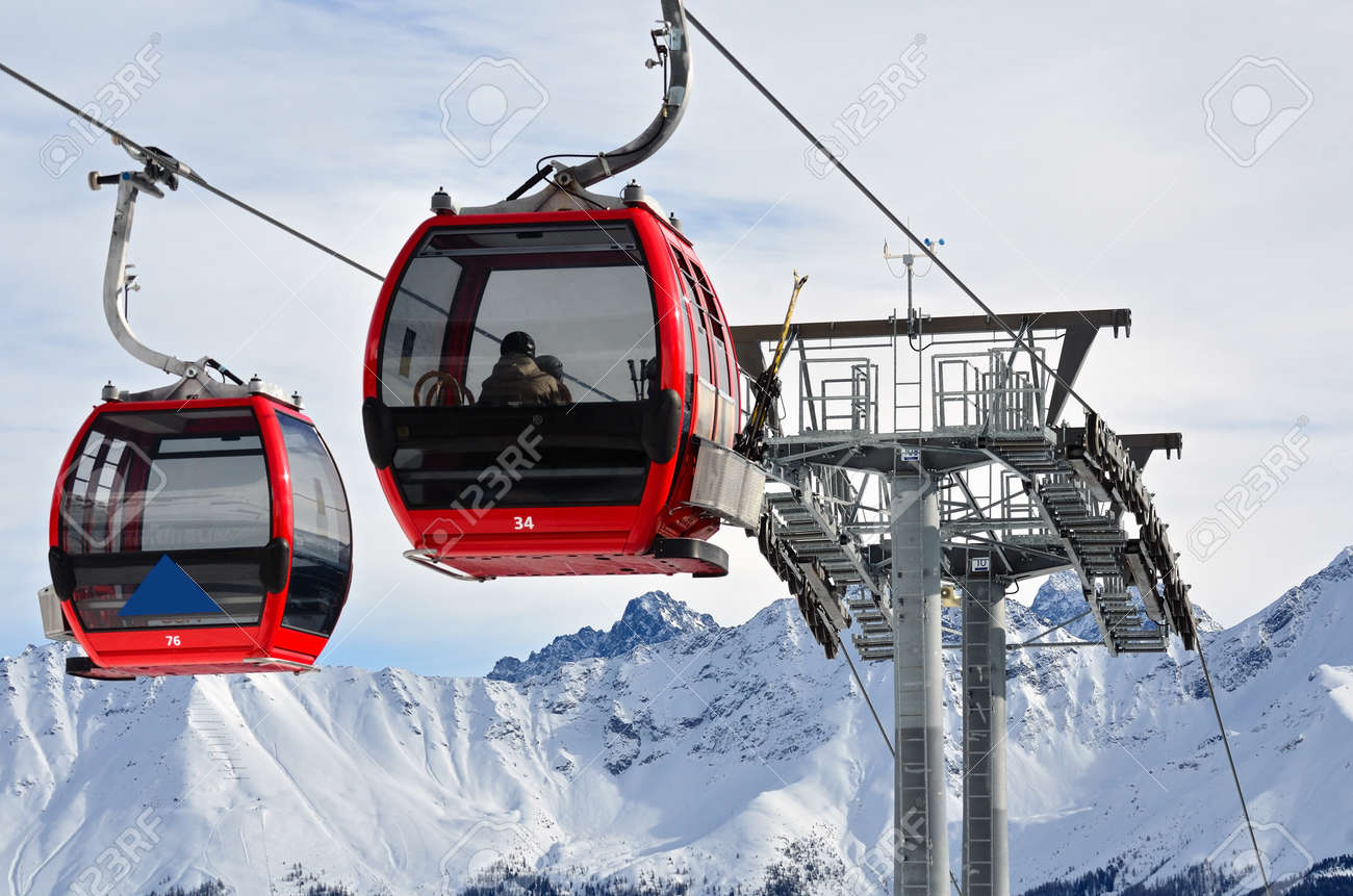 Red cable car in the skiing resort in Alps - 161006189