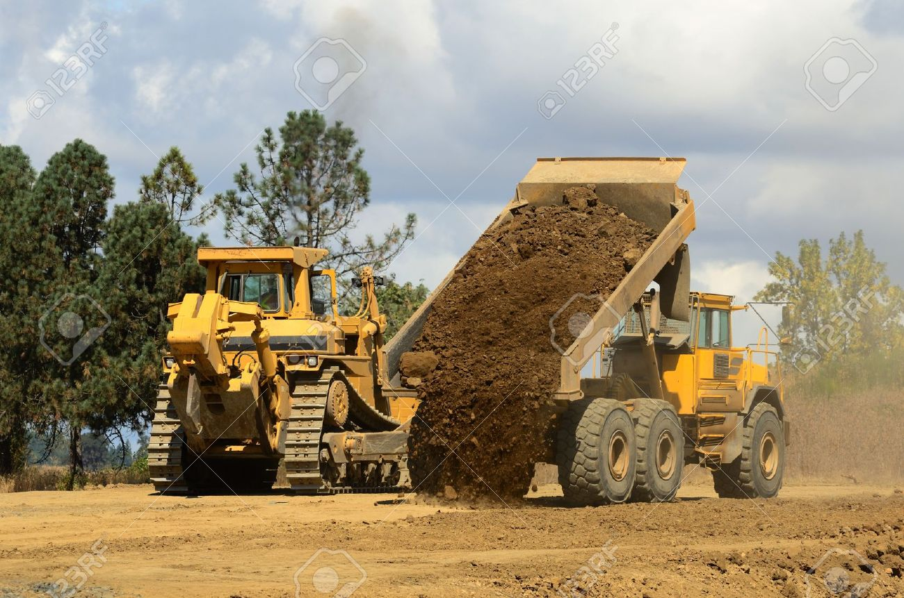 A large track bulldozer and a large articulating dump truck at a new road project in Oregon Stock Photo - 10945820