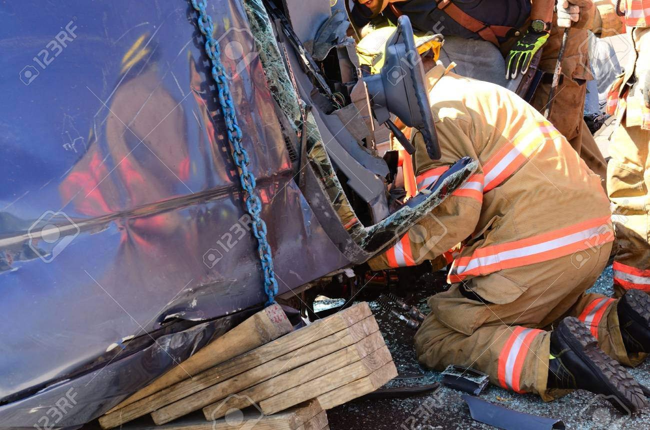 Firefighters work on an extrication using a hydraulic rescue