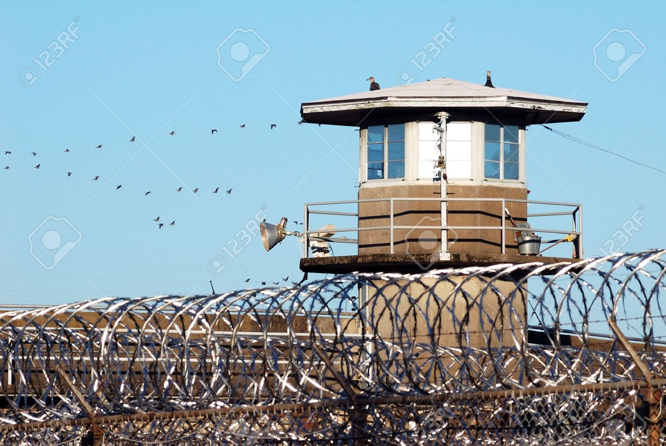 Prison guard and guard stand on the edge of the Oregon State Prison in Salem Oregon Stock Photo - 14638870
