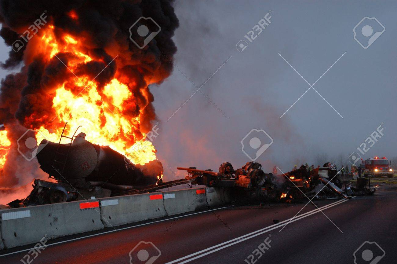 Truck carrying 10,000 gals of fuel wrecked into construction divider Stock Photo - 16516732