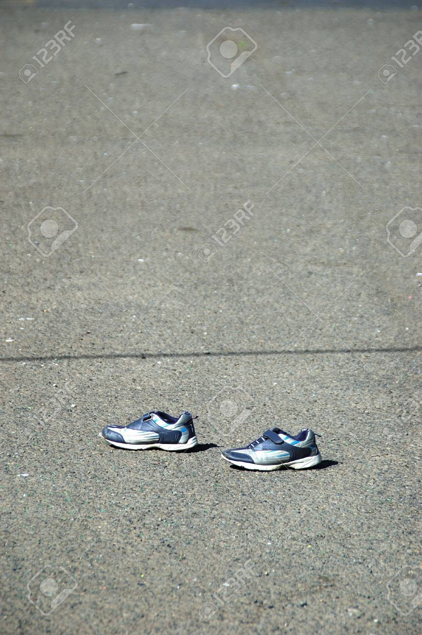 Invisible Man  Shoes found in a parking lot near a thrift store, Portland OR Stock Photo - 17618459