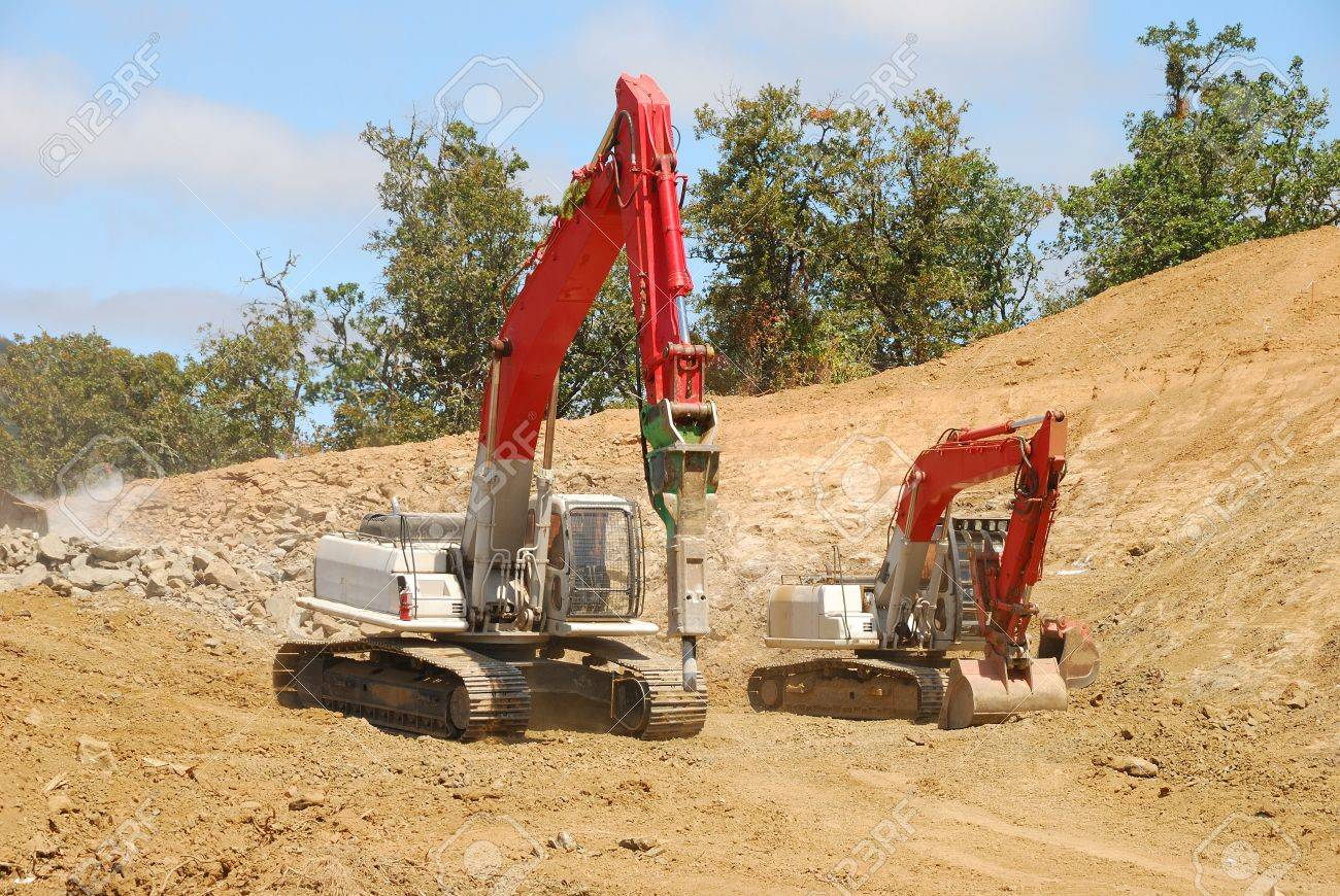 Large tracked excavator using a hydraulic breaker or rock jack
