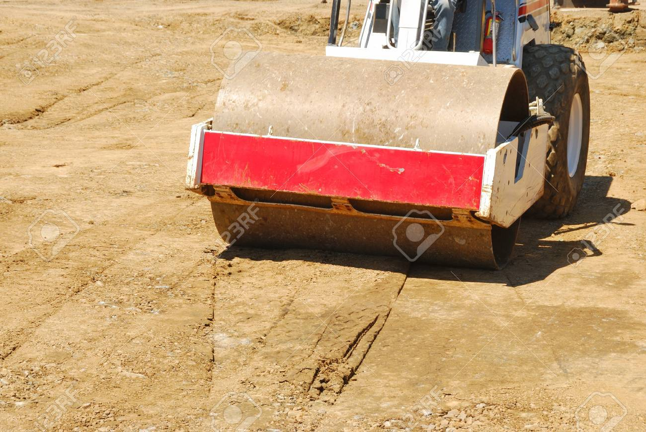 Compacting the soil during site prep with a vibration roller on a new business  project in Roseburg Oregon Stock Photo - 19820135