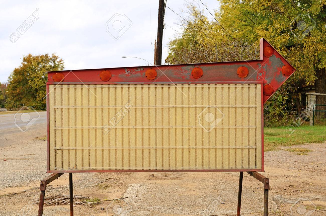 A Old Sign Board With An Arrow Sits With No Letters Stock Photo