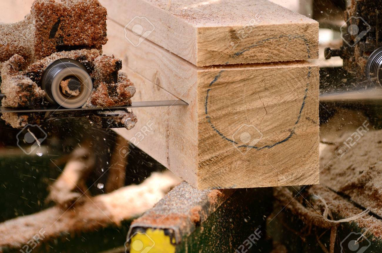 Small Portalble Bandsaw Sawmill Being To Cut A Cedar Log Into Dimension Lumber In