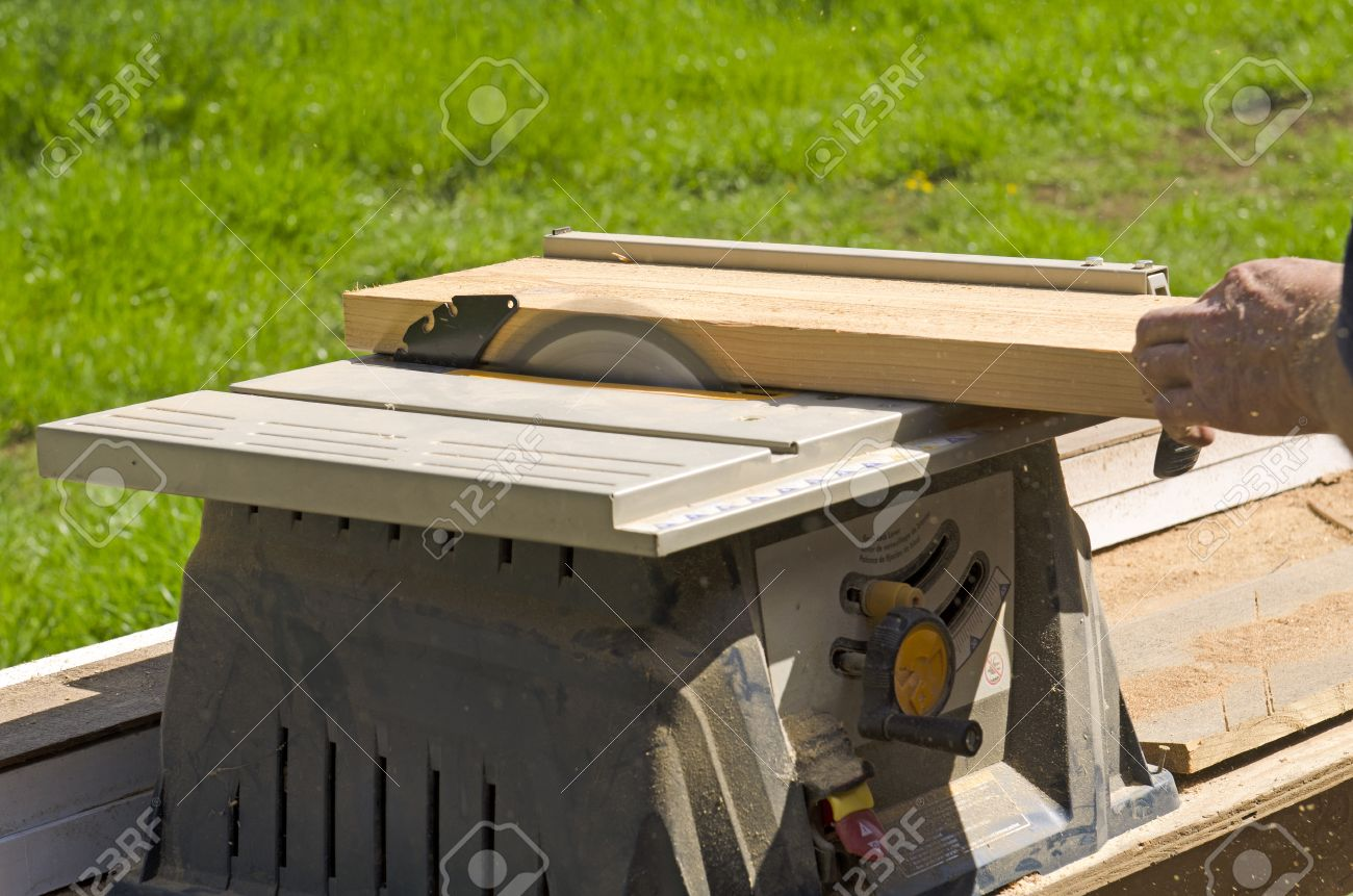 Magnificent Wood Siding Contractor Using A Table Saw To Cut Window And Door Download Free Architecture Designs Scobabritishbridgeorg