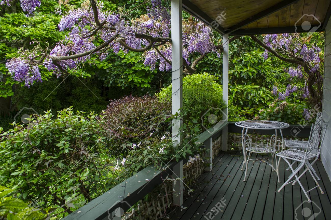 White Table And Chair On Dream House Porch And Tree With Purple