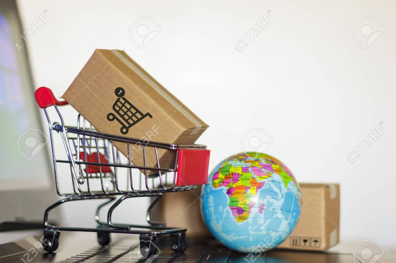 Trolley with boxes and earth globe on computer  Online shopping,