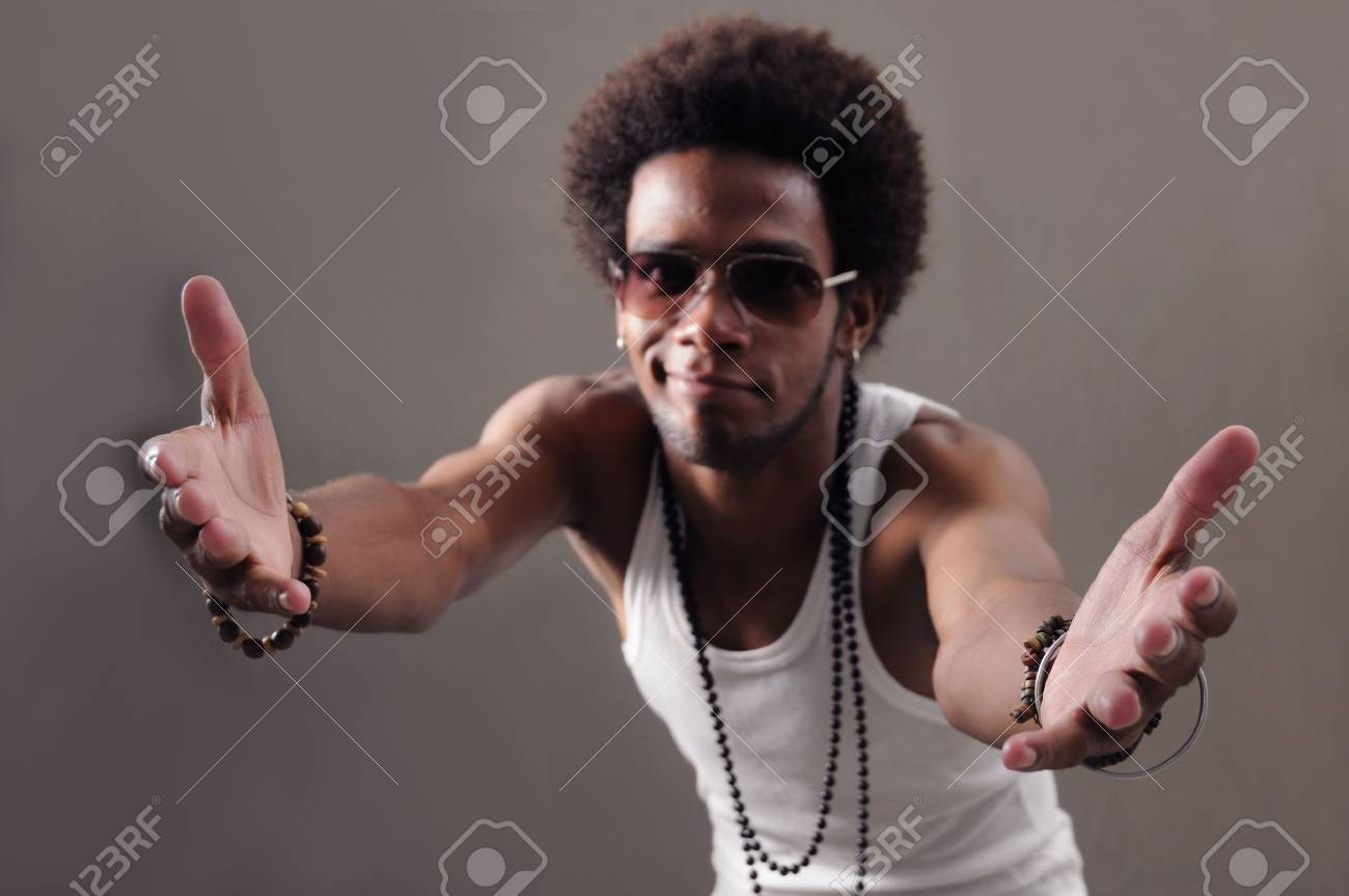 Portrait of young african male with open arms towards the camera Stock Photo - 3250377