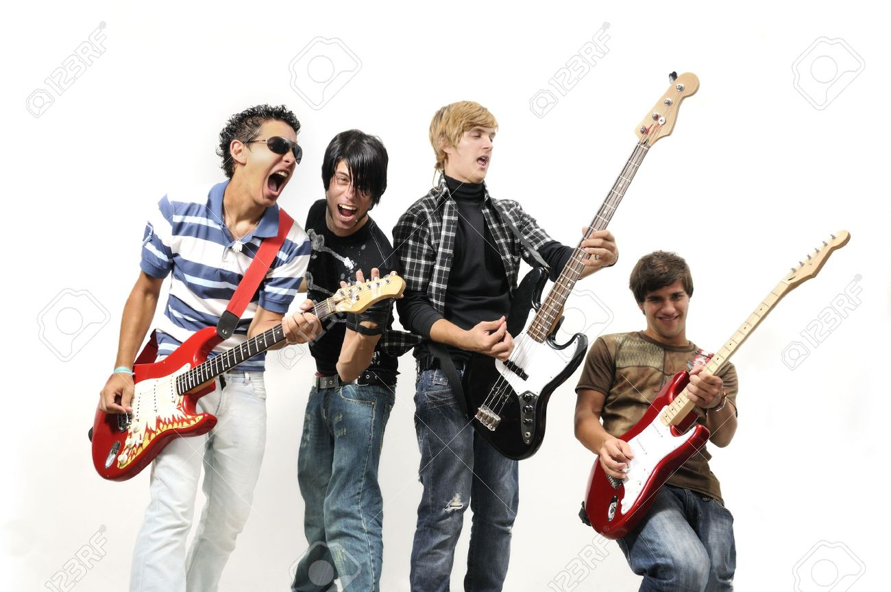 Portrait of young musical band playing with instruments - isolated Stock Photo - 3478467