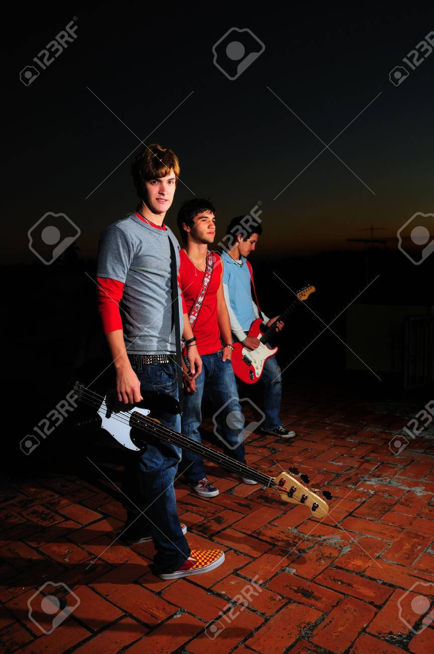 Portrait of young trendy musiciands holding instruments Stock Photo - 3872007