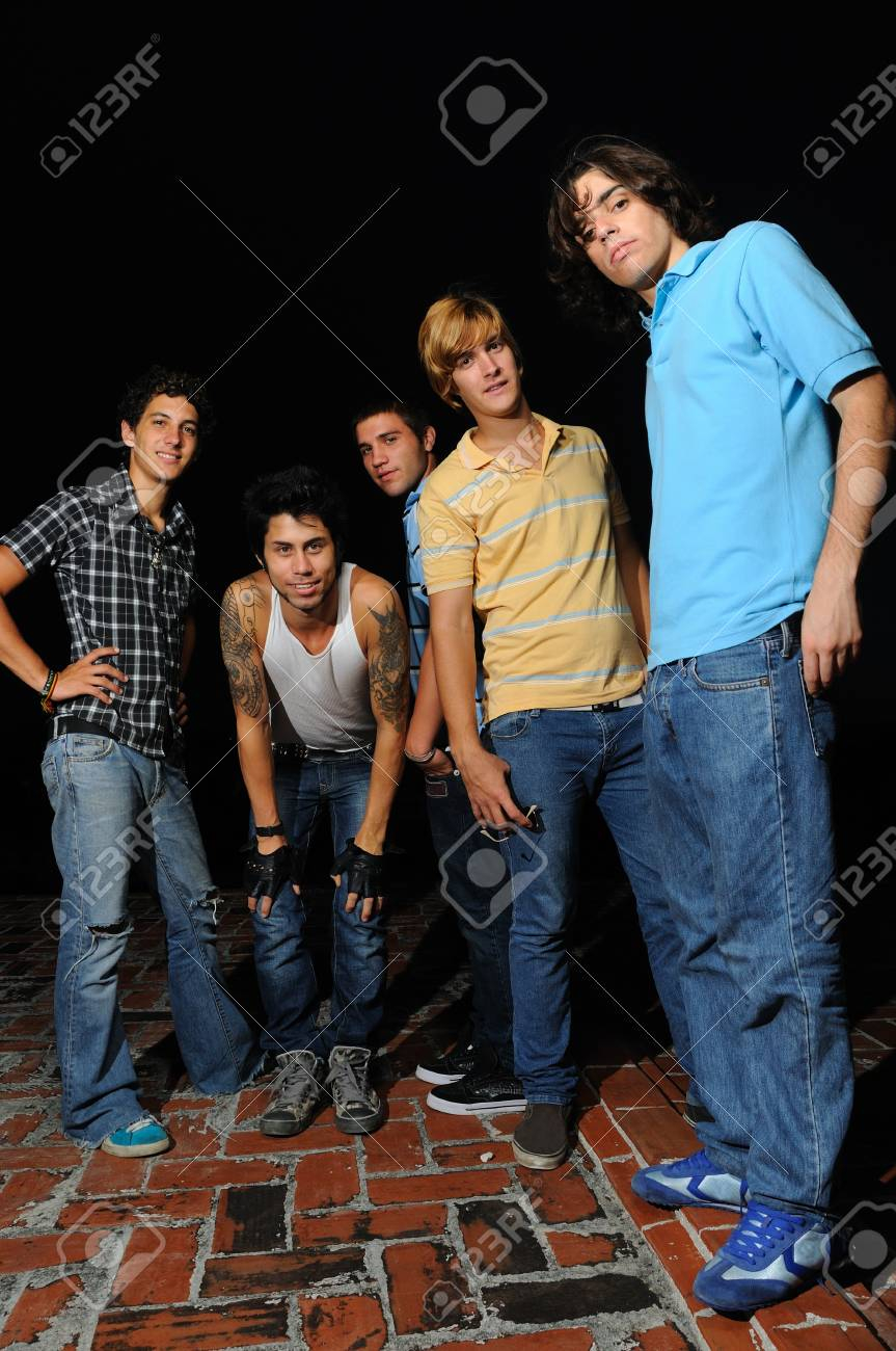 Portrait of young trendy group of friends standing with attitude Stock Photo - 4012107