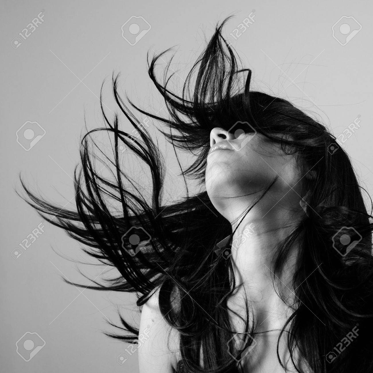 Portrait of young female beauty with long dark hair in black and white Stock Photo - 4008511