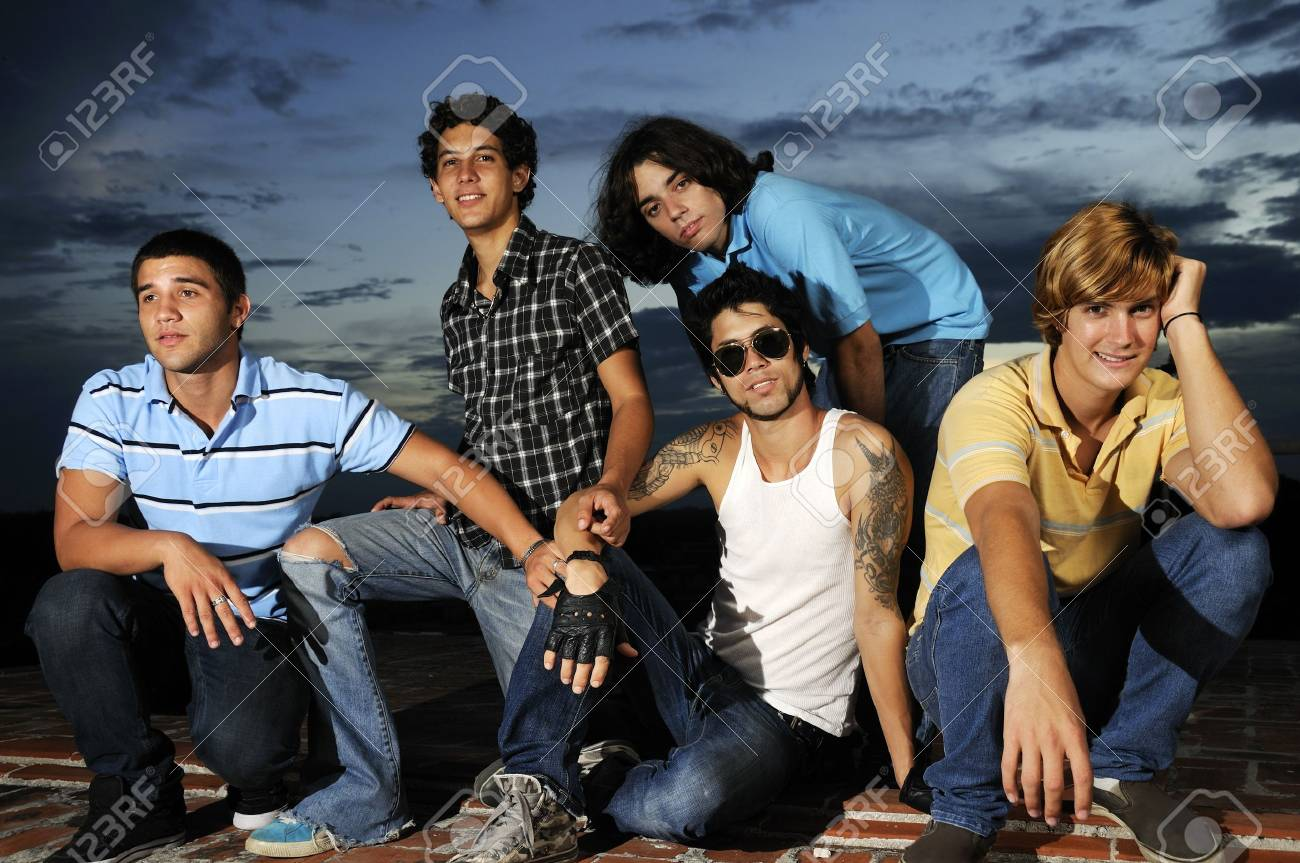 Portrait of young trendy group of friends standing with attitude Stock Photo - 4343571