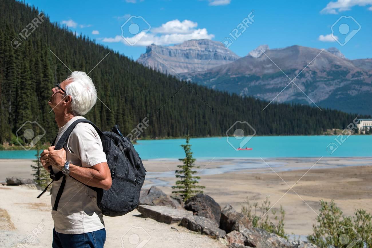 Old man hiking at lake Louise - 91286183