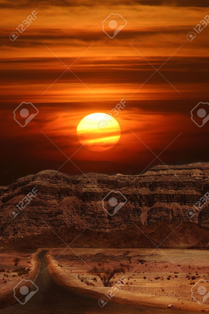 Vertical oriented image of sunset over the mountains of Arava desert in Israel. Stock Photo - 10462686