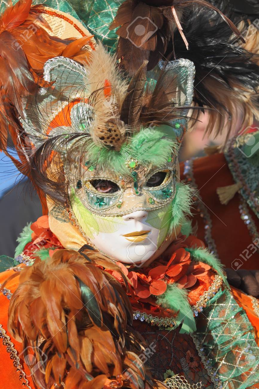 VENICE, ITALY - MARCH 04: Unidentified participant wear traditionall mask and clothing during famous Venetian Carnival on March 04, 2011 in Venice, Italy. Stock Photo - 17227425