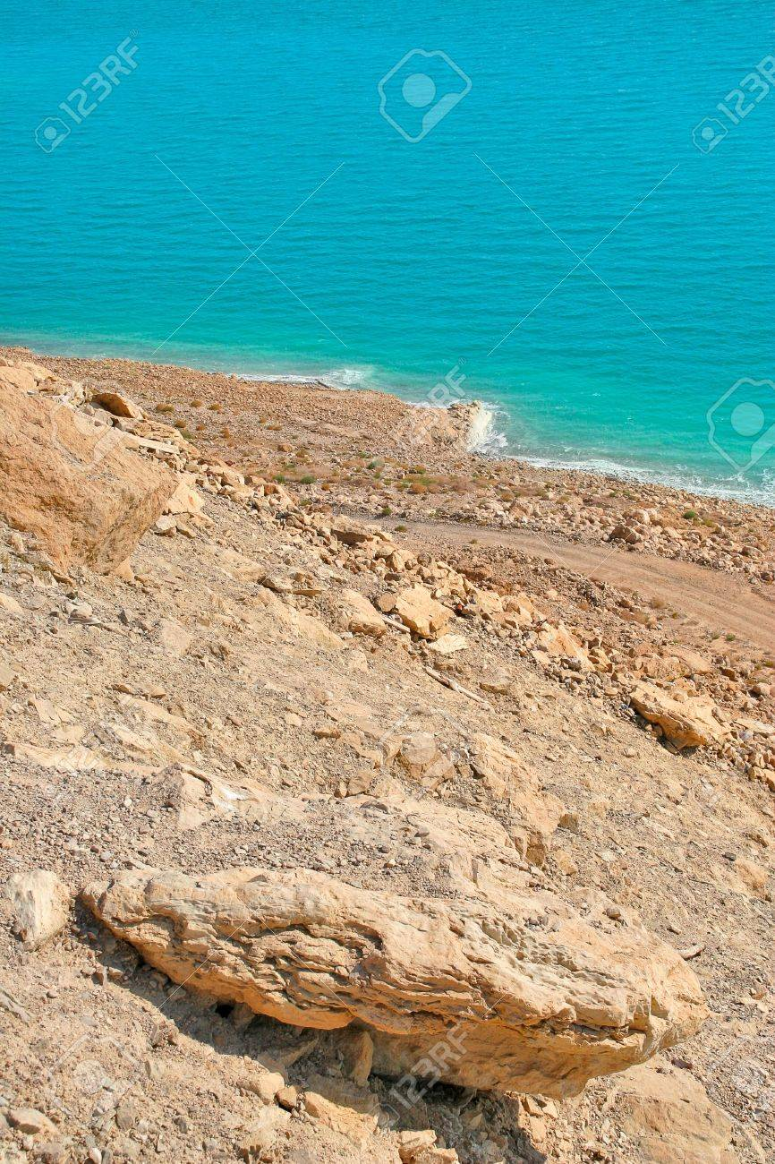 Vertical oriented image on rocky slope and deserted coast on Dead Sea in Israel Stock Photo - 18393510