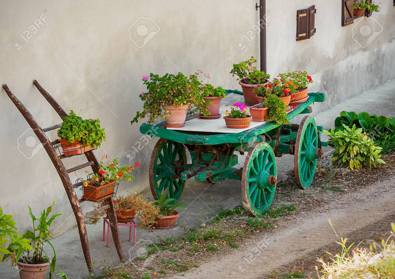 Pots With Flowers On Top Of Green Wooden Cart As Part Of Rural ...