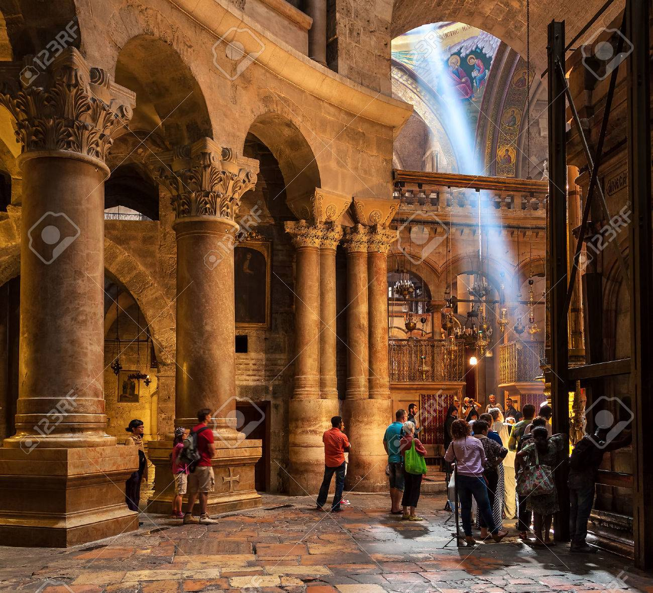 JERUSALEM, ISRAEL - JULY 26, 2015: People inside the Church of the Holy Sepulchre - holy place where according christian tradition Jesus was crucified, buried and resurrected. - 62872611