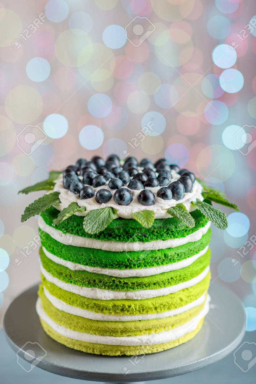 Nice Sponge Happy Birthday Cake With Mascarpone And Grapes On The Stand Festive Light