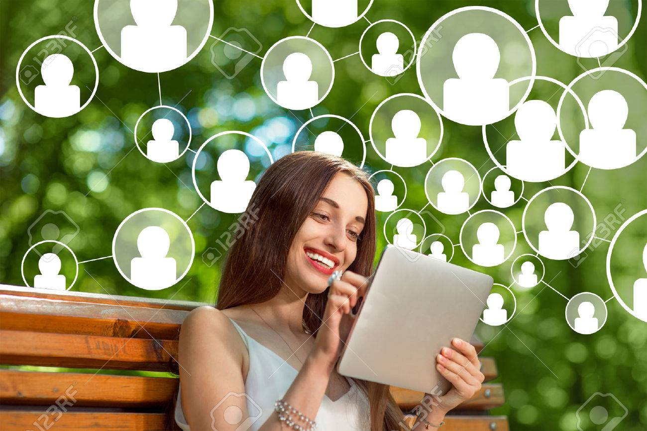 Young woman adding friends in social media with digital tablet in th park - 36164908