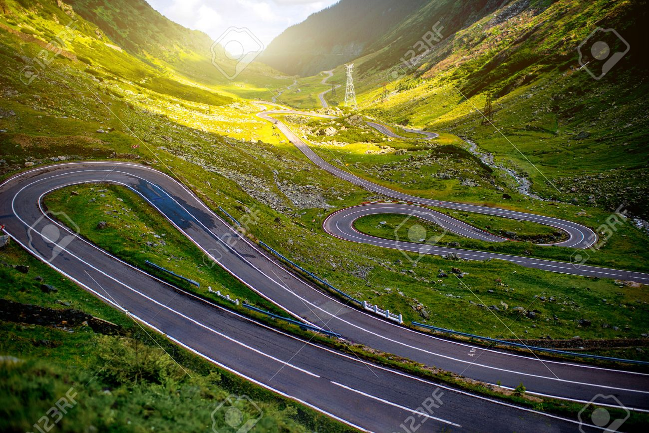 Landscape from the Fagaras mountains with Transfagarasan winding road in Romania - 42121512