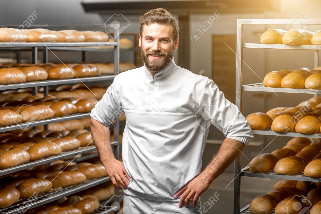 Portrait of handsome baker at the bakery with breads and oven on the background - 54120272