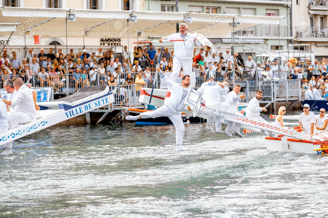 SETE, FRANCE - July 30, 2017: Water jousting competition which lasted in Sete on the south of France. Jousting is a fight on the boat practised principally in France - 91067885