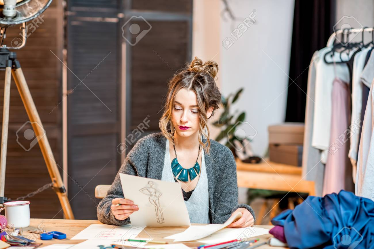 Young Female Fashion Designer Sketching Drawings Of The Clothes Stock Photo Picture And Royalty Free Image Image 91547225