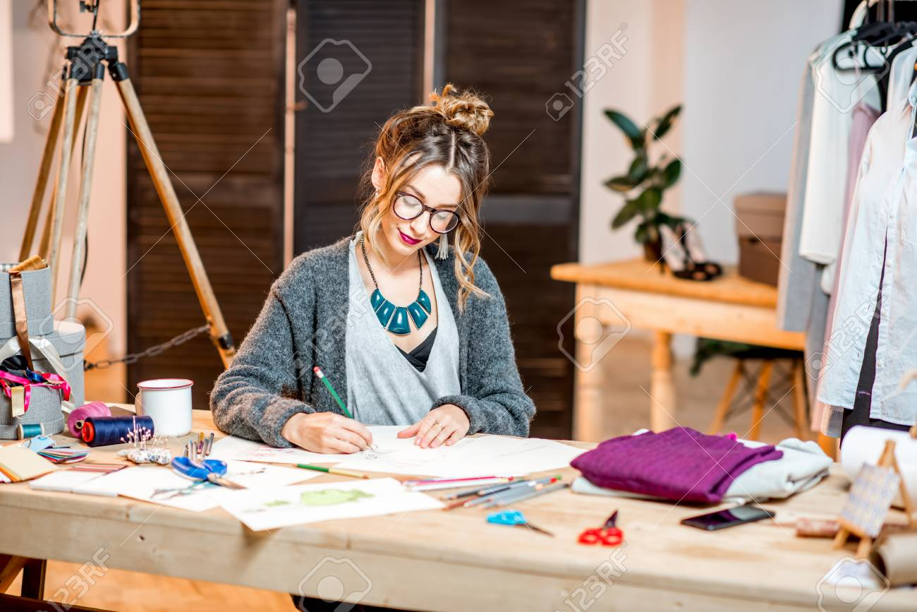 Young Female Fashion Designer Sketching Drawings Of The Clothes Stock Photo Picture And Royalty Free Image Image 92337128
