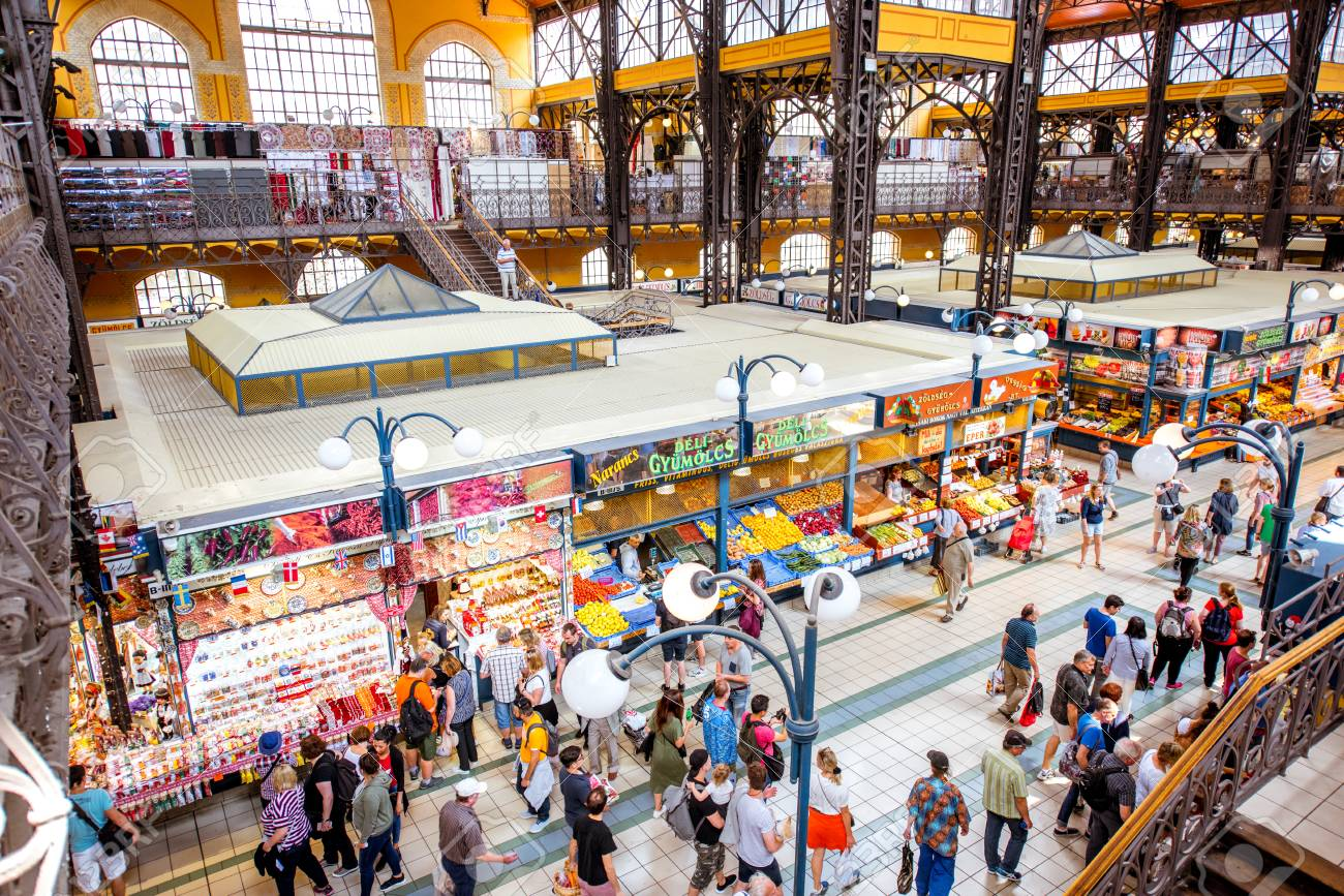 HUNGARY, BUDAPEST - MAY 19, 2018: Interior of the famous Great Market hall crowded with people, this building is largest and oldest indoor market in Budapest, Hungary - 105120633