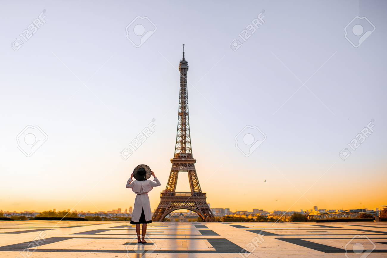 Famous square with great view on the Eiffel tower and woman standing back enjoying the view in Paris - 109823451