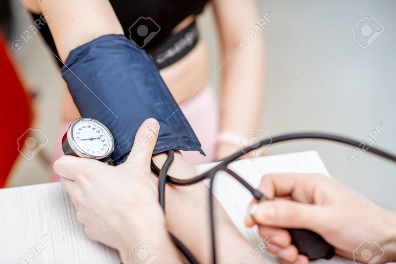 Close-up of a blood pressure measuring process - 116648407