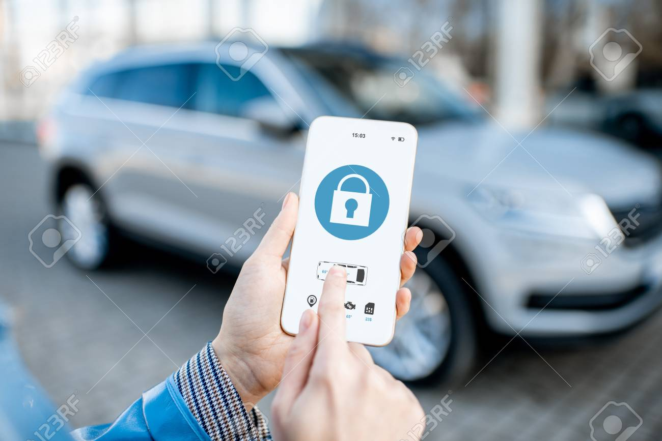 Locking car using mobile application on a smart phone. Concept of remote control and car protection through the internet - 119987399