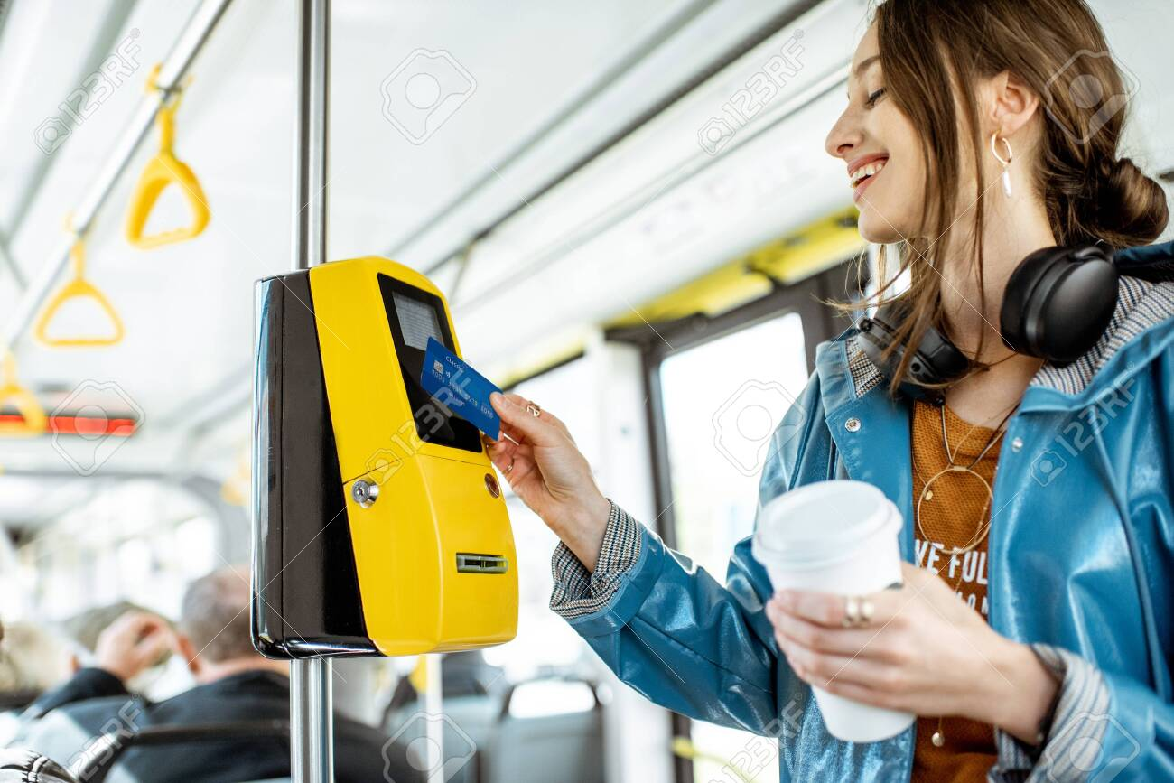 Woman paying conctactless with bank card for the public transport in the tram - 123396453